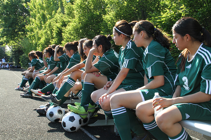 In The Game - Girls Team Sitting On Bench